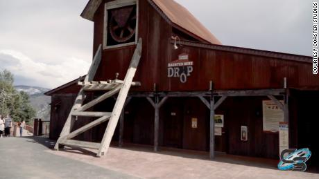 A view of the outside of the Haunted Mine Drop attraction from 2019.