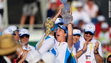 Europe's Georgia Hall holds up the trophy after their team win the Solheim Cup.