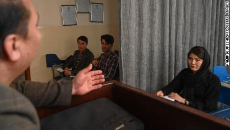 A teacher lectures students at a  university in Afghanistan's capital on September 7.
