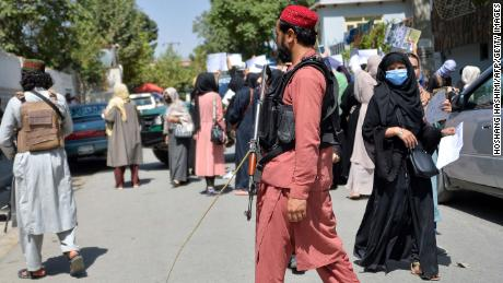 Taliban fighters are seen during the protest on Tuesday.