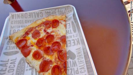 CNN Business Senior Writer Rachel Metz tested the new Ray-Ban Stories smart glasses. She tried to use them to photograph a slice of pizza, but couldn't capture the whole thing.