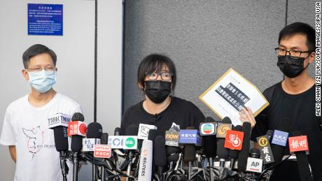 Chow Hang-tung and two other committee members of the Hong Kong Alliance at a press conference in Hong Kong on September 7.