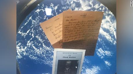 Personal items from the Keller family that went to space include one of Chad's letters as well as his memorial program.
