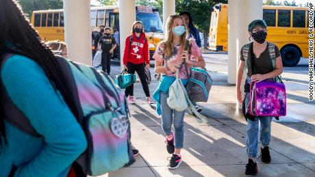 Students arrive by bus for the first day of school at Kernodle Middle School in Greensboro, North Carolina, on August 23, 2021.