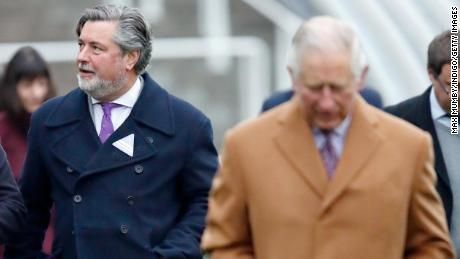 Michael Fawcett, former valet to Prince Charles and current chief executive of the Prince's Foundation (L), accompanies Prince Charles at Ascot Racecourse in England on November 23, 2018.