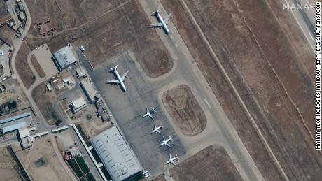 A handout satellite image made available by Maxar Technologies shows airplanes near the main terminal at Mazar-i-Sharif Airport, northern Afghanistan, on September 3, 2021.