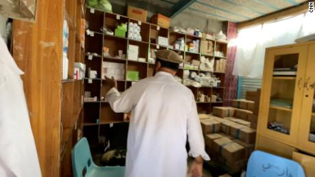 Khan displays the hospital's stock room, as concern grows over access to healthcare in the country.