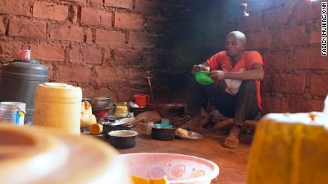 Ibrahim Chombo inside his house. He says he and his family struggle for enough food to eat.