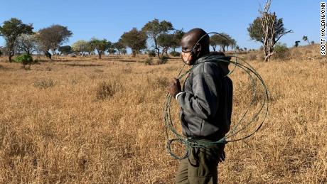 A ranger at Taita hils with a snare left by poachers