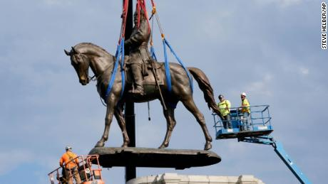 Crews remove the 12-ton statue of Confederate General Robert E. Lee on Monument Avenue in Richmond.