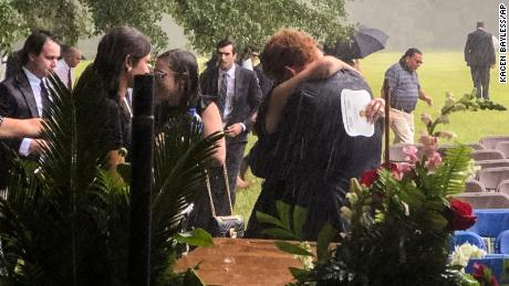 Buster Murdaugh, center, receives a hug in the rain during the funeral service for his brother, Paul, and mother, Maggie, on June 11 in Hampton, South Carolina.