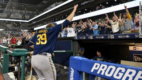 Corbin Burnes of the Milwaukee Brewers waves to fans as he leaves the field after throwing a combined no-hitter on Saturday.
