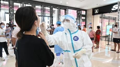 China's strict 21 day quarantine under question after new outbreak emerges