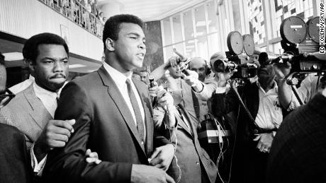 """Ali tells the assembled media """"no comment"""" during a recess in his trial for dodging the US military draft in 1967."""