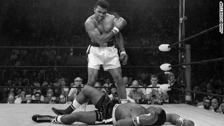 Ali stands over the fallen Sonny Liston, shouting and gesturing on May 25, 1965 in one of history's most iconic sport images.
