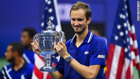 Medvedev celebrates with the US Open tophy - his first major title.