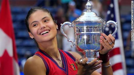 Britain's Emma Raducanu celebrates with the trophy after winning the 2021 US Open.
