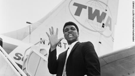 Cassius Clay, before he changed his name to Muhammad Ali, photographed en route back to the US after beating Henry Cooper in 1963.