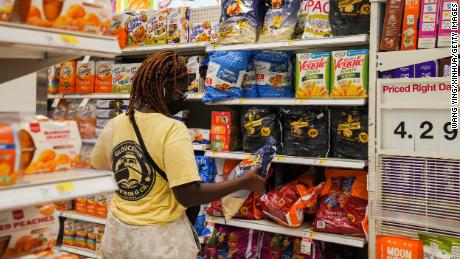 A customer selects goods at a supermarket in New York, on Aug. 11, 2021.