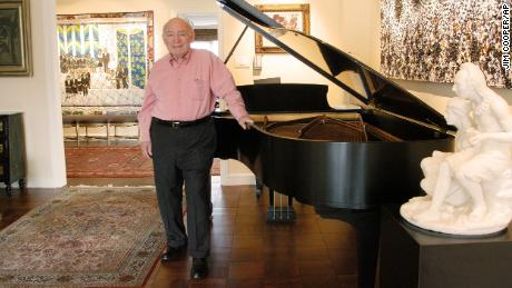 George Wein poses at his New York apartment in 2004.