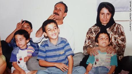 Navid Afkari (bottom left), sitting with his brother Vahid (top left), brother Saeid (bottom center), brother Habib (bottom right), father (top center) and mother (top right).
