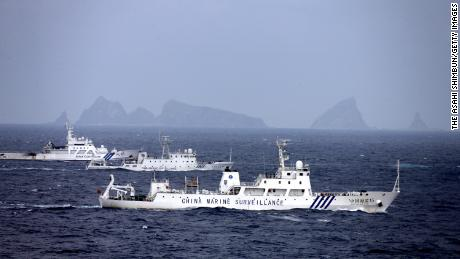 China Marine Surveillance vessels (front and middle) cruise with a Japan Coast Guard ship near Kitakojima and Minamikojima of the disputed Senkaku Islands on April 23, 2013.