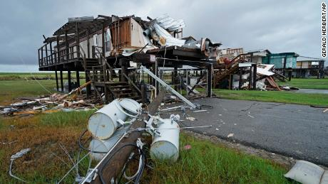 Storm clouds from Nicholas are seen Tuesday behind homes destroyed by Hurricane Ida in Pointe-aux-Chenes, Louisiana.