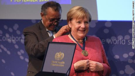 Merkel receives a medal from Tedros Adhanom Ghebreyesus, Director General of the World Health Organization, during the opening of a WHO hub in Berlin on September 1, 2021.