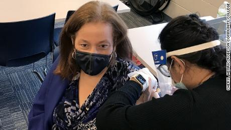 Robeson Community College President Melissa Singler receives the flu vaccination during the joint Covid-19/flu clinic held at the college.