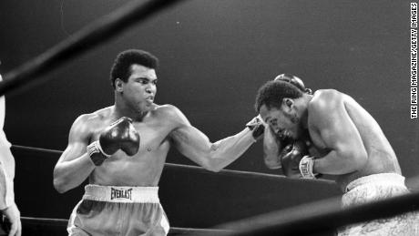 Ali lands a left hook on Joe Frazier during their fight at Madison Square Garden on March 8, 1971.