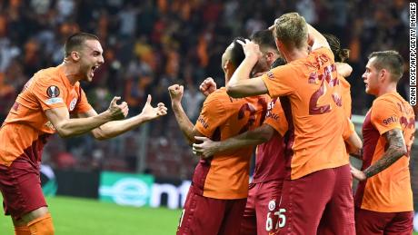 Galatasaray's players celebrate taking the lead.