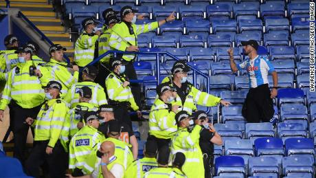 Police had to separate both sets of fans inside the stadium.