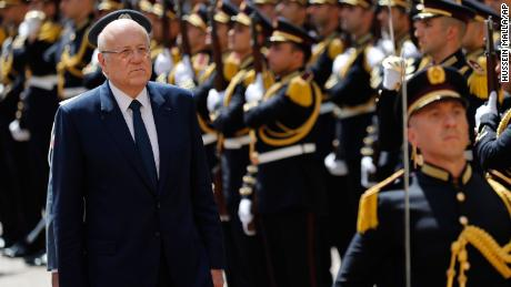 Lebanese Prime Minister Najib Mikati, reviews an honor guard during a ceremony at the Government House in downtown Beirut, Lebanon, on September 13, 2021.