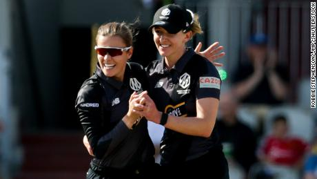Alex Hartley (left) and Kate Cross celebrate a wicket while playing for the Manchester Originals on August 10.