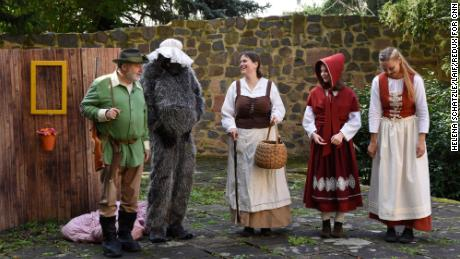 """Characters perform """"Little Red Riding Hood"""" at the monestary garden."""