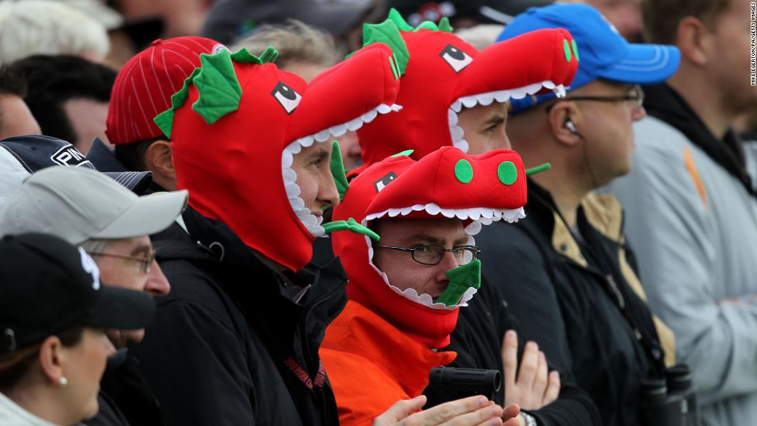 Welsh fans in dragon outfits watch the play during the 38th Ryder Cup.