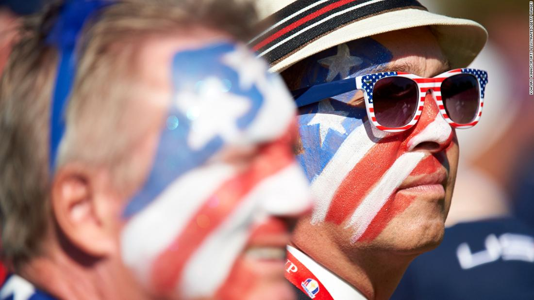 Team USA fans with faces painted in red, white, blue, stars and stripes at Hazeltine National in 2016.