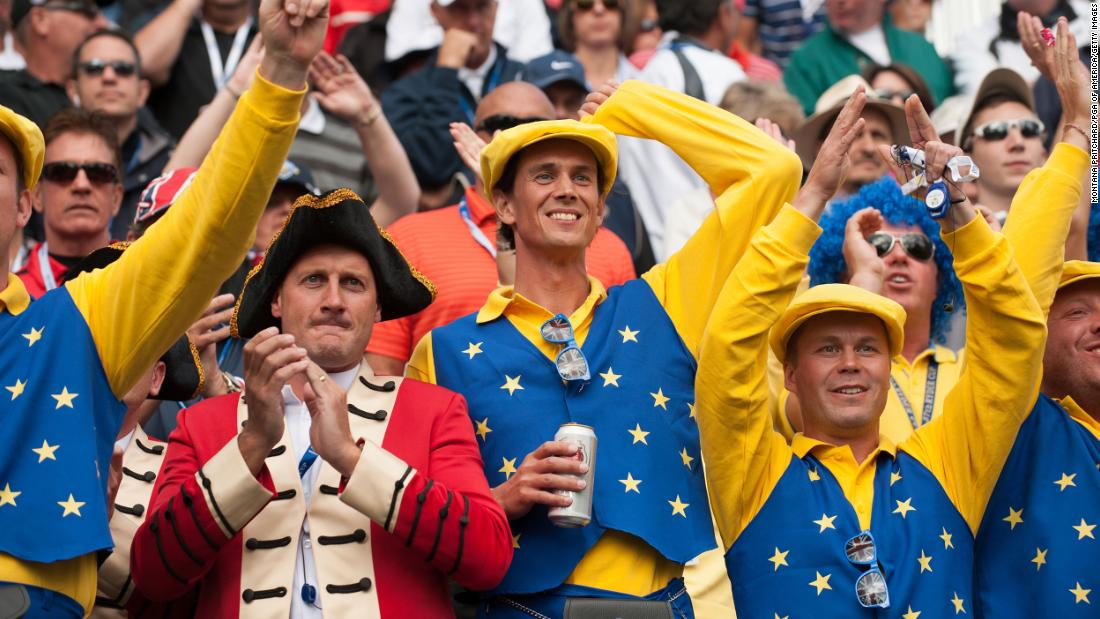 European team fans cheer at the first hole during the morning foursome matches for the 39th Ryder Cup in Illinois.