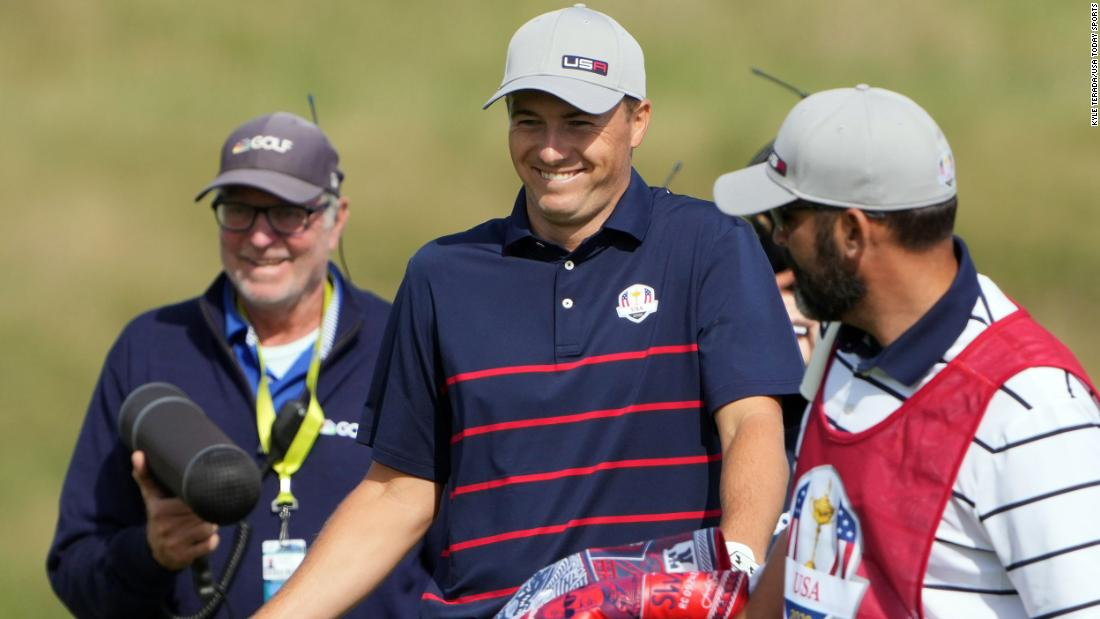 Jordan Spieth reacts to seeing his shot after walking back up onto the 17th green following his shot from the edge slope.