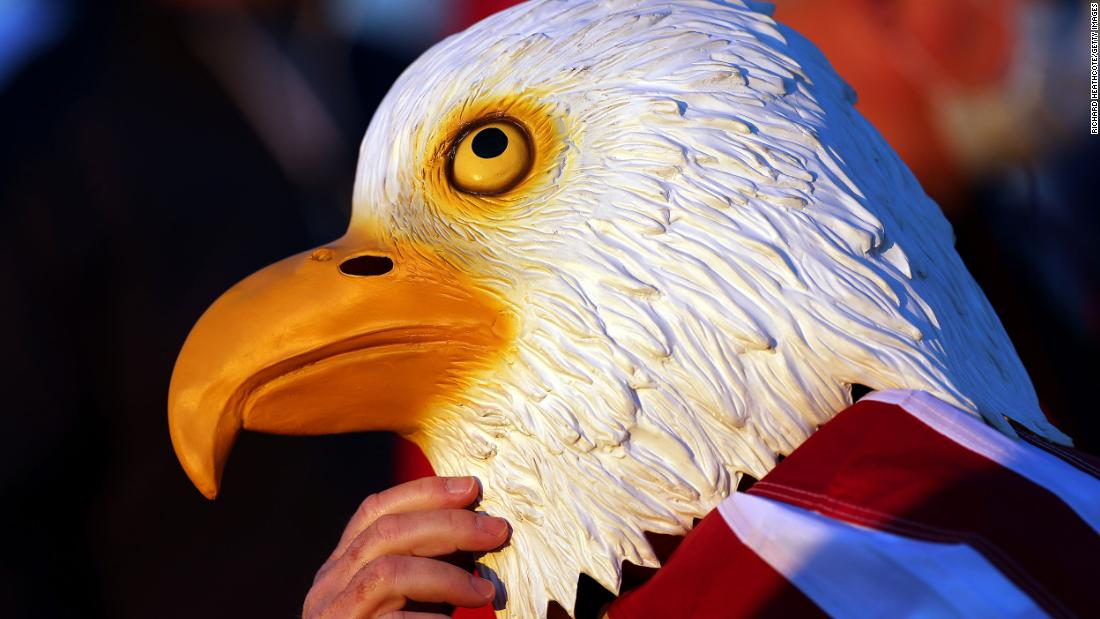 A fan of Team US wears a bald eagle mask during Friday morning Foursome matches.
