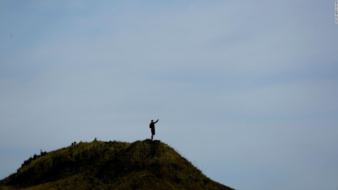 A fan watches from a hill on the 11th hole during a Foursome match the Ryder Cup at the Whistling Straits.