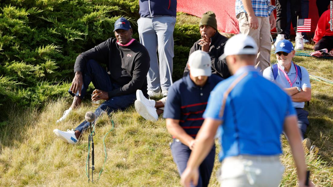Basketball legend Michael Jordan watches by the 11th green during the Fourballs on day one of the Ryder Cup.