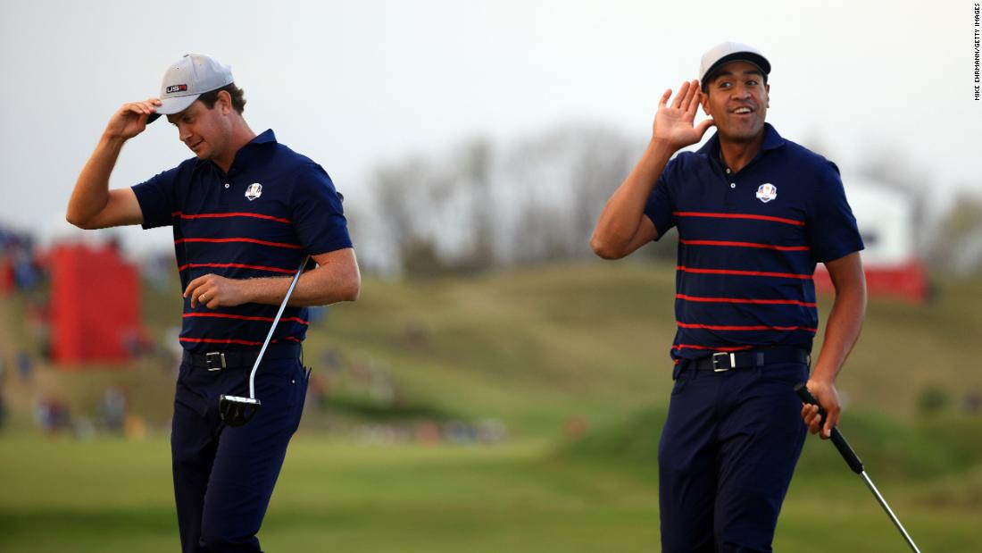 Harris English (left) and Tony Finau celebrate on the 15th green after winning their Fourball match.