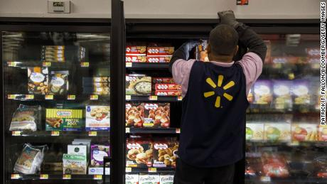 An employee restocks frozen food products at a Walmart store in Burbank, California, on November 26, 2019.
