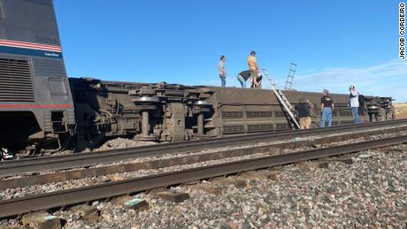 An Amtrak car lies on its side after derailing on Saturday in Montana.