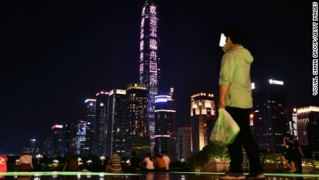 Shenzhen's tallest skyscraper, the Ping An Finance Centre, is lit up with a message welcoming Meng Wanzhou home.