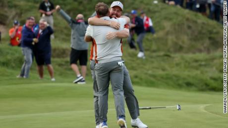 Lowry and Hatton celebrate their win over English and Finau on the 18th green.
