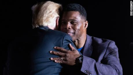 Former President Donald Trump hugs Georgia Senate candidate Herschel Walker during his Save America rally in Perry, Ga., on Saturday, Sept. 25, 2021.