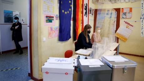 Voters cast their ballots in the federal parliamentary elections in Berlin, Germany.