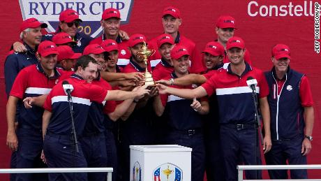 Team US poses with the trophy at the closing ceremony of the Ryder Cup.